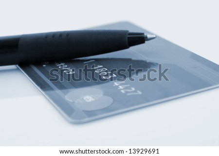 credit card and pen on a white background