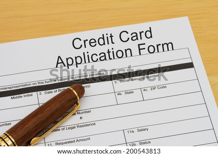 Credit Card Application Form with a pen on a wooden desk