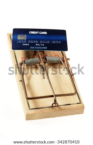 Credit card as bate on mousetrap isolated over white background - stock photo