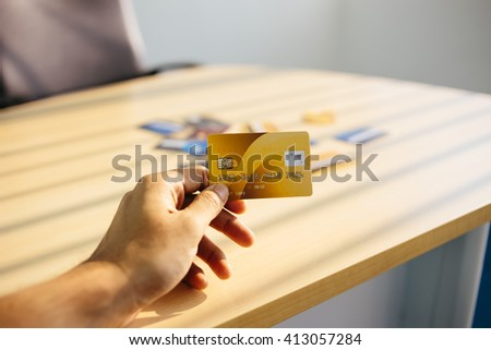 Credit card concept with window light on desk - stock photo