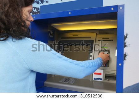Credit card in a ATM - stock photo
