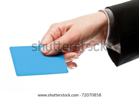 Credit card in a male hand isolated on white