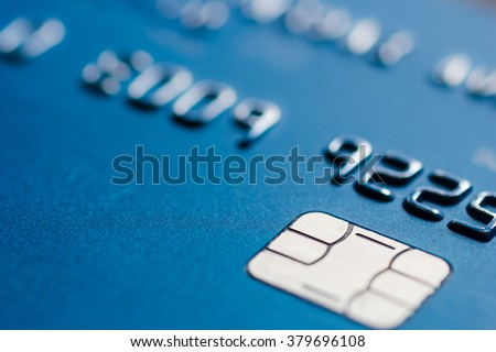 Credit card in blue with chip close up atm emv blurred - stock photo