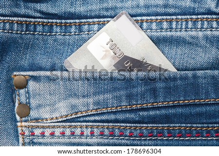 credit card in the pocket of jeans. close-up - stock photo