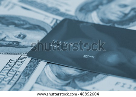Credit card isolated on american dollars background