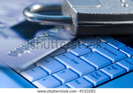 Credit card, lock, and a computer laptop keyboard for safety and security on the internet - stock photo