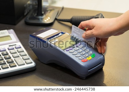 Credit Card Machine In Store - stock photo