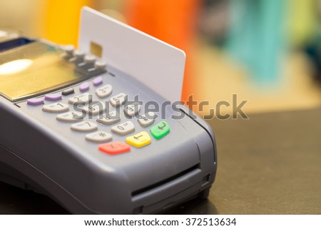 Credit Card Machine With Credit Card (Selective Focus) - stock photo