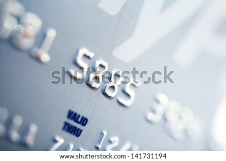 Credit Card Number Closeup. Banking and Transaction Technology. Credit Card in Macro Photography. - stock photo