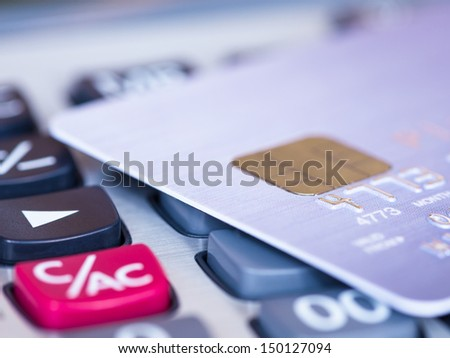 Credit card on a calculator - stock photo
