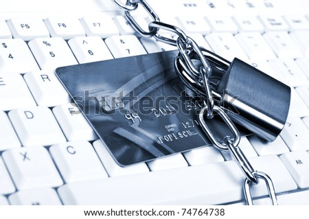 Credit card on an white keyboard - stock photo