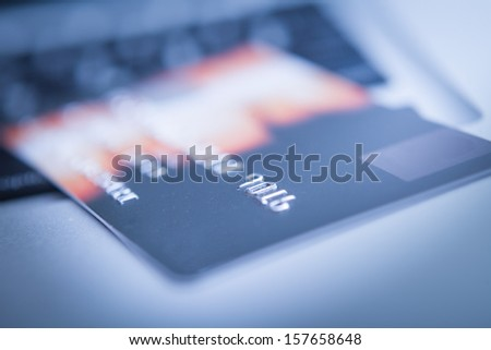 Credit Card on computer with a pen - stock photo