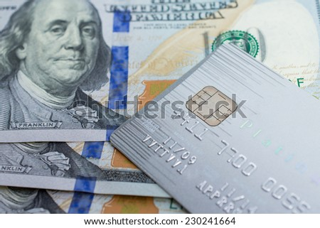Credit Card on dollar bills as wealthy concept - stock photo