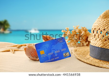 Credit card on holiday on blurred resort background - stock photo