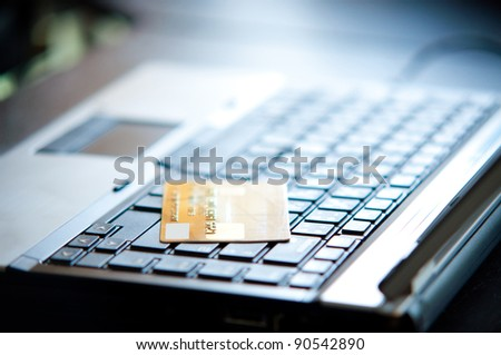 credit card on laptop for online shopping concept - stock photo