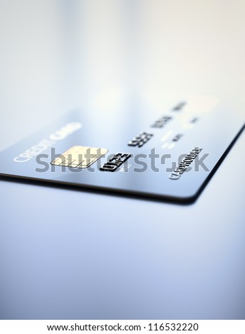 Credit Card on reflective table- 3d rendered shallow DOF - stock photo