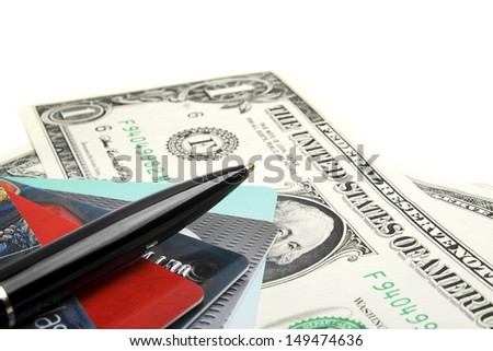 Credit card, pen and money closeup