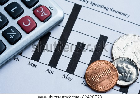 Credit card spending summary, calculator, coins and pen. Concept of finance. - stock photo
