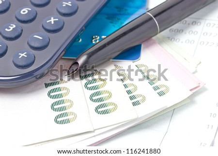 Credit card, Thai bank notes and calculator with bankbook. - stock photo