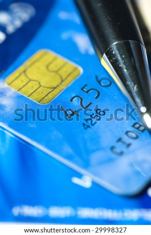 credit card with black pencil and narrow focus - stock photo