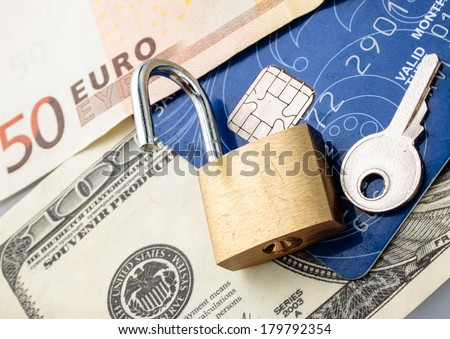 Credit card with chip, money, padlock and key. - stock photo