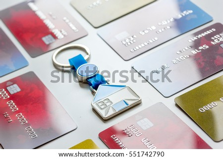 credit cards concept mortgag for new home on white background
