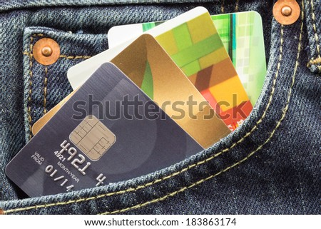 credit cards in blue jeans pocket - stock photo