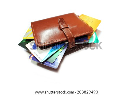 Credit cards in wallet on a white background. - stock photo
