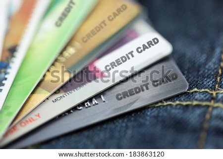 credit cards on jeans focus at first card - stock photo