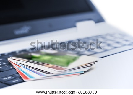 Credit cards on the notebook - stock photo