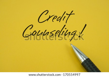 Credit Counseling! note with pen on yellow background