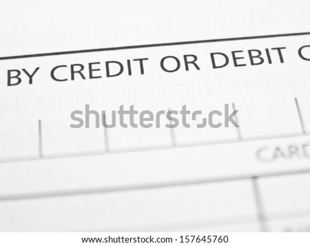 CREDIT OR DEBIT written on a form or contract close up.