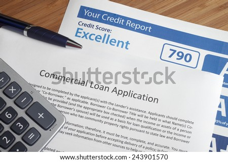 Credit report with score on a desk - stock photo
