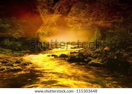 creek in hazy valley - stock photo