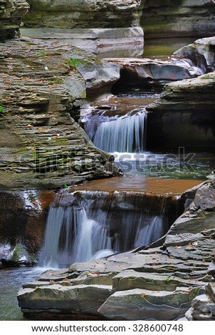 creek in mountain with rocks and stream in Watkins Glen state park in New York State - stock photo