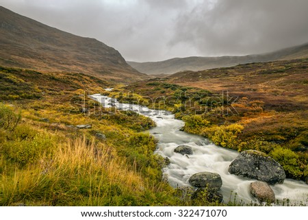Creek in the Mountain pass over Sognefjellet providing access to Jotunheimen and Jostedalsbreen National Parks, Norway. Long exposure. - stock photo