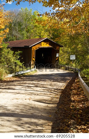 Creek Road covered bridge in Ashtabula County, Ohio on a fall day - stock photo