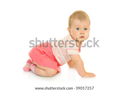 Creeping small baby in red dress