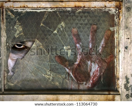 Creepy Eye Zombie looking through Broken Glass Window with Bloody Hand against the window - stock photo