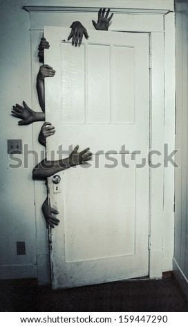 Creepy image of multiple hands opening a door - stock photo