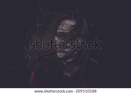 Creepy, Young girl with hair flying, concept nightmares - stock photo