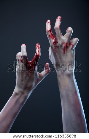 Creepy zombie hands, extreme body-art, studio shot