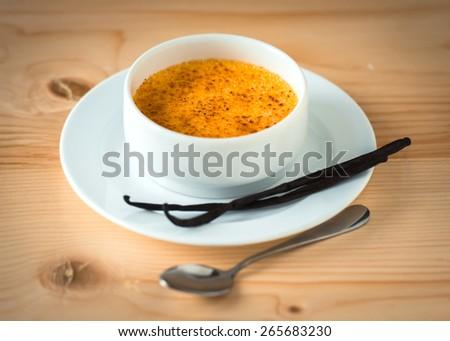 Creme brulee with bourbon vanilla sticks - stock photo
