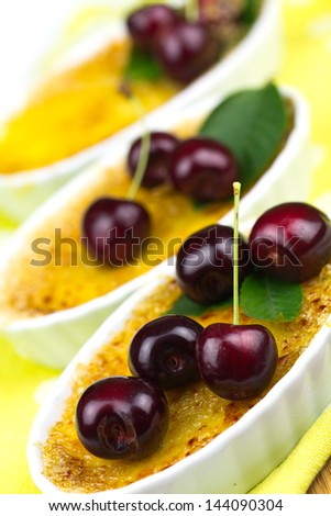 creme brulee with cherry - stock photo