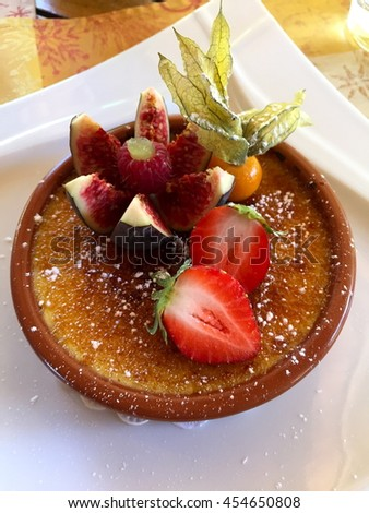 Creme Brulee with fresh fruits (strawberry, fig, raspberry, ground cherry)