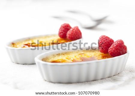 Creme brulee with raspberries. - stock photo