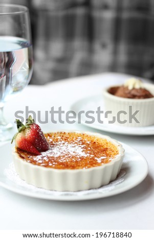 Creme brulee with strawberry - stock photo