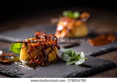 Creme caramel decorated with caramel lattice - stock photo