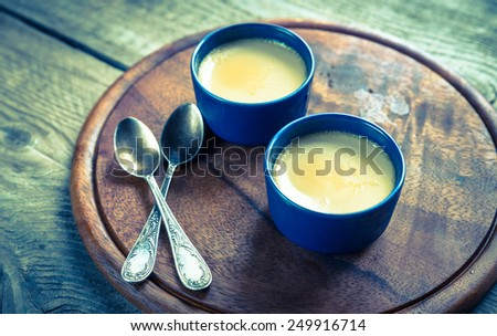 Creme caramel in the pots - stock photo