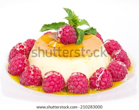 Creme caramel with raspberries. isolated on white background